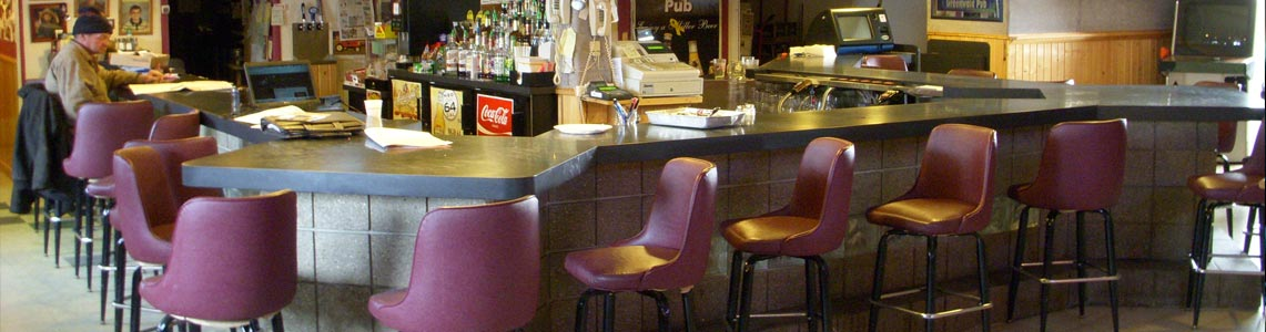 Inside the Greenwald Pub with a look at the u-shaped bar top and numerous bar stools