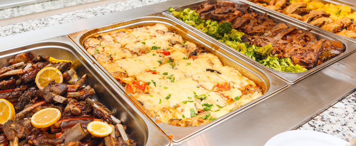 Buffet food warmers filled with fresh, homemade dishes