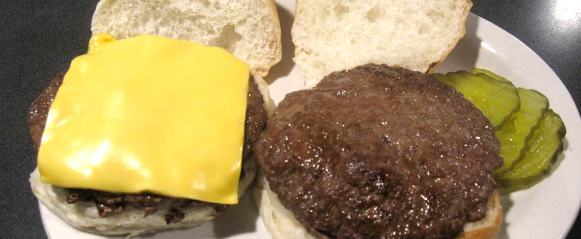 Cheeseburger on an open bun and Hamburger on an open bun